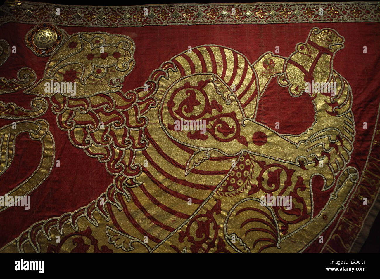 A tiger hunts a camel. Detail of the Coronation mantle, 1133-34, Palermo. Imperial Treasury, Hofburg Palace, Vienna, - Stock Image