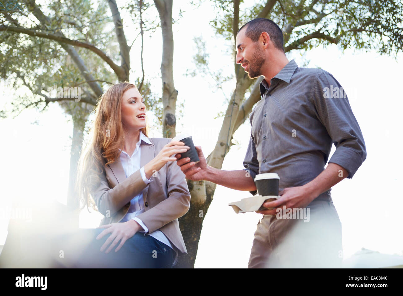 Businessman and business woman having coffee - Stock Image
