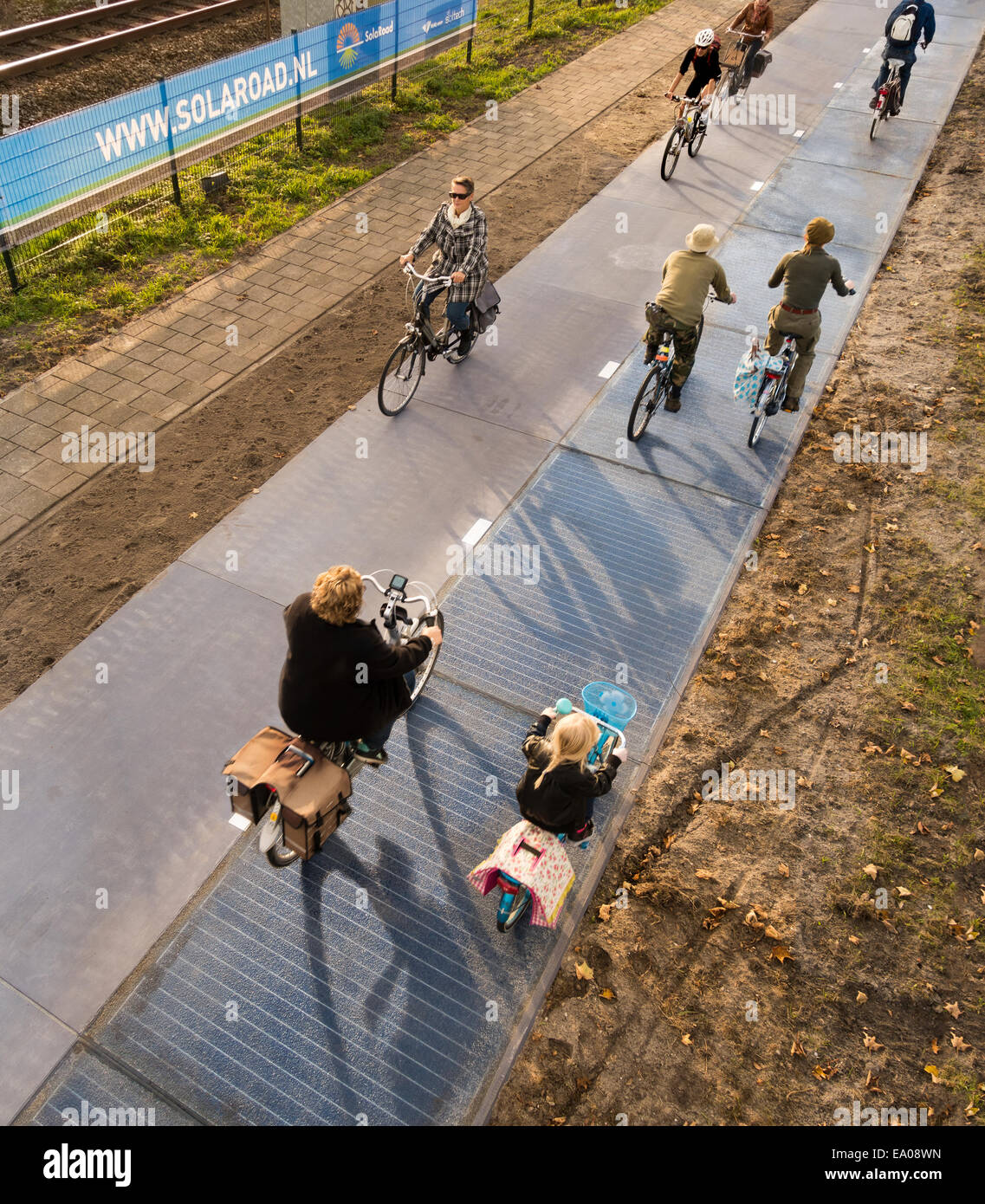 Netherlands, Holland, Krommenie, world's first cycle lane made from solar cells with cyclists people on busy - Stock Image