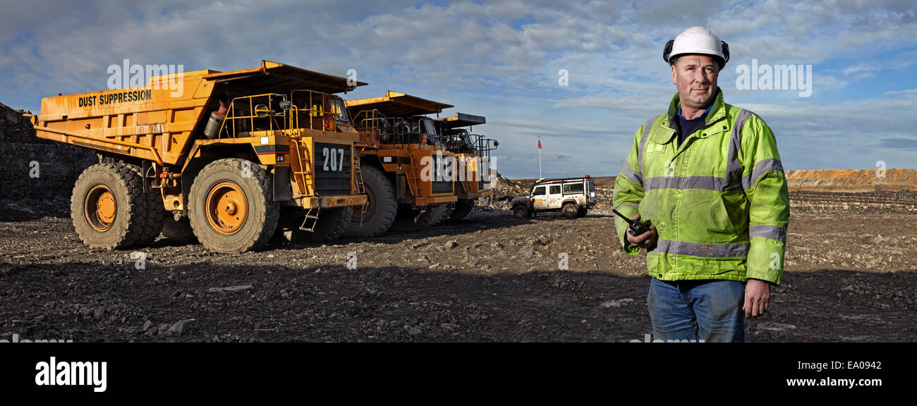 Portrait of foreman with walkie talkie working at quarry - Stock Image