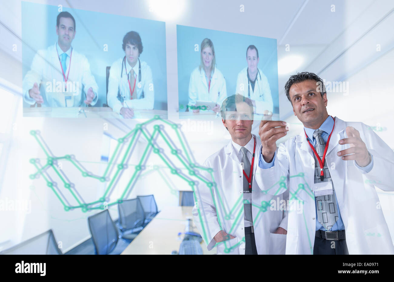 Medical specialists discussing results through video conference on futuristic display - Stock Image