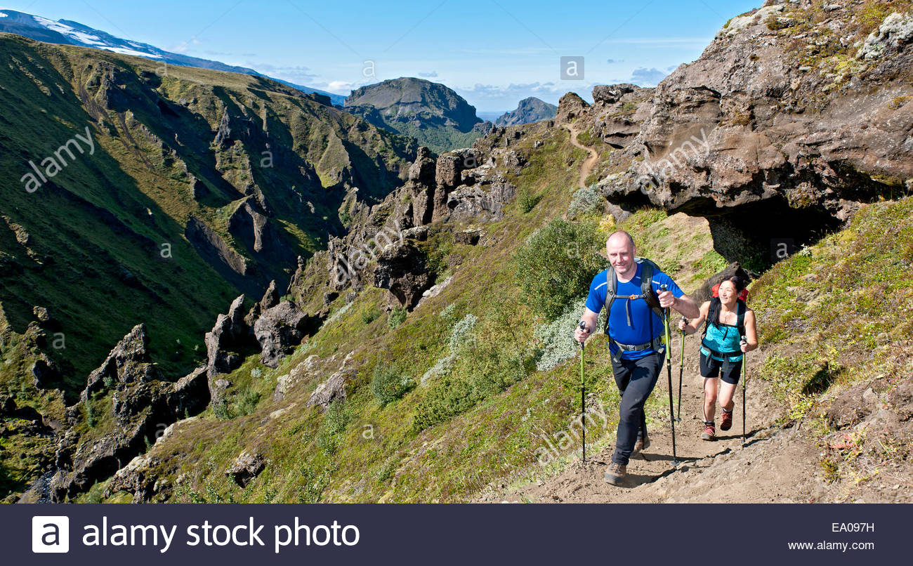 Couple hiking up to Fimmvordurhals Pass above Thorsmork Valley, Thorsmork, South Iceland, Iceland - Stock Image