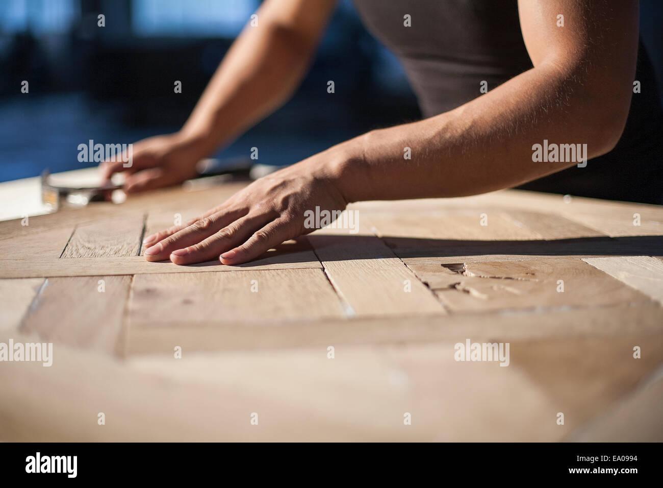 Carpenter piecing together wood blocks in factory, Jiangsu, China - Stock Image