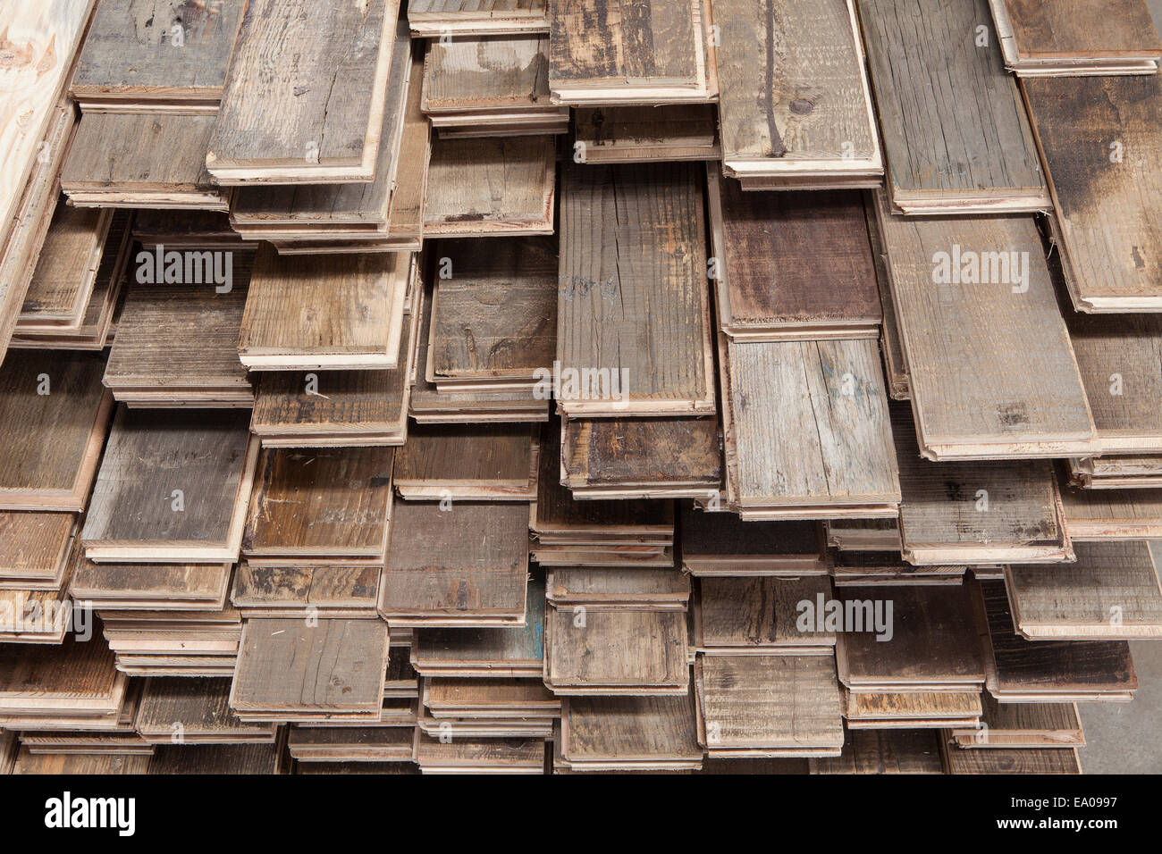 Stacks of treated wood flooring in factory, Jiangsu, China - Stock Image