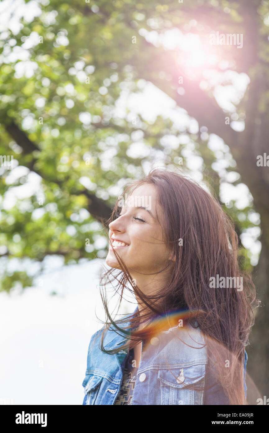 Teenager enjoying breeze - Stock Image