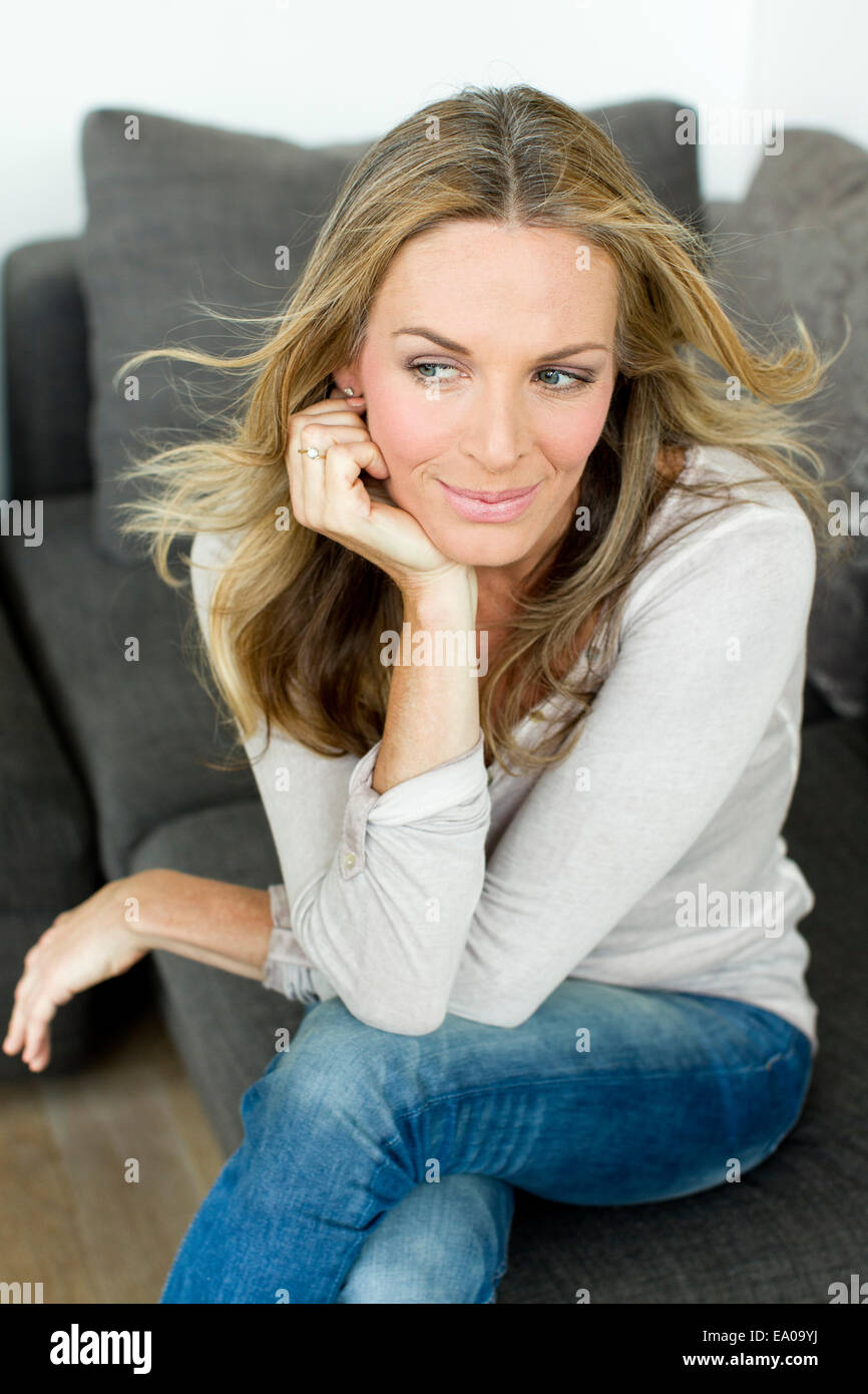 Mature blonde woman with hand on chin, portrait Stock Photo