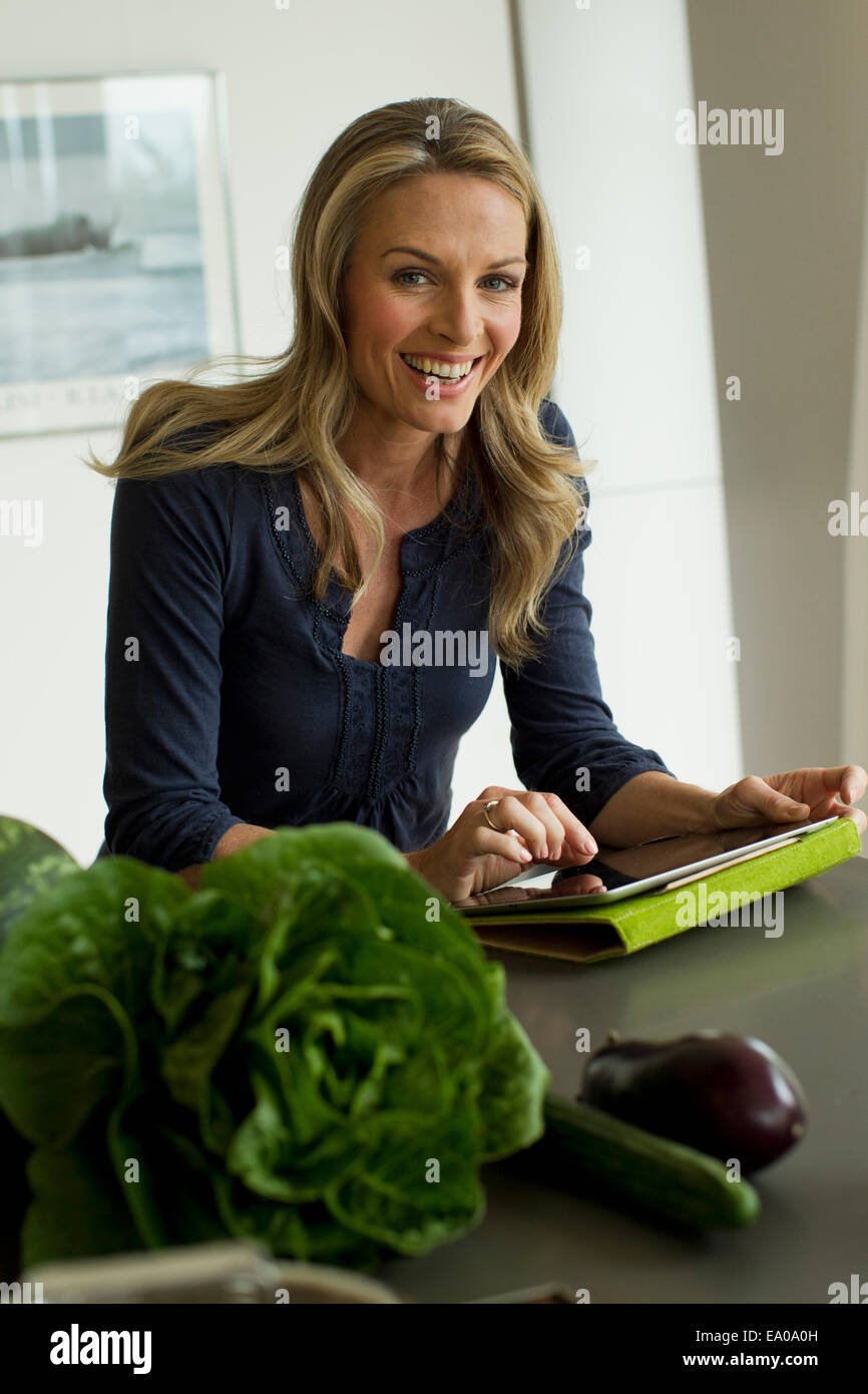 Mature woman using digital tablet - Stock Image