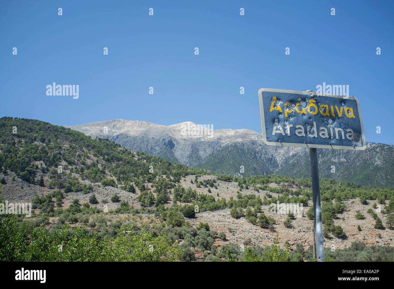 Bullet ridden sign, Aradaina, Crete - Stock Image