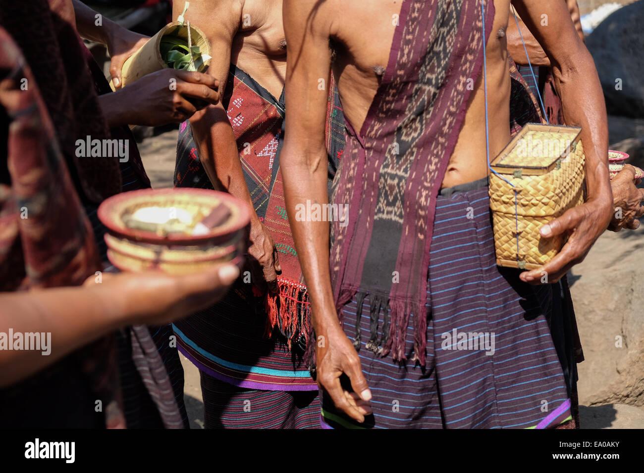 Local people bring small baskets containing betel and Areca (sirih and pinang) in Lamagute, Lembata, Indonesia. - Stock Image