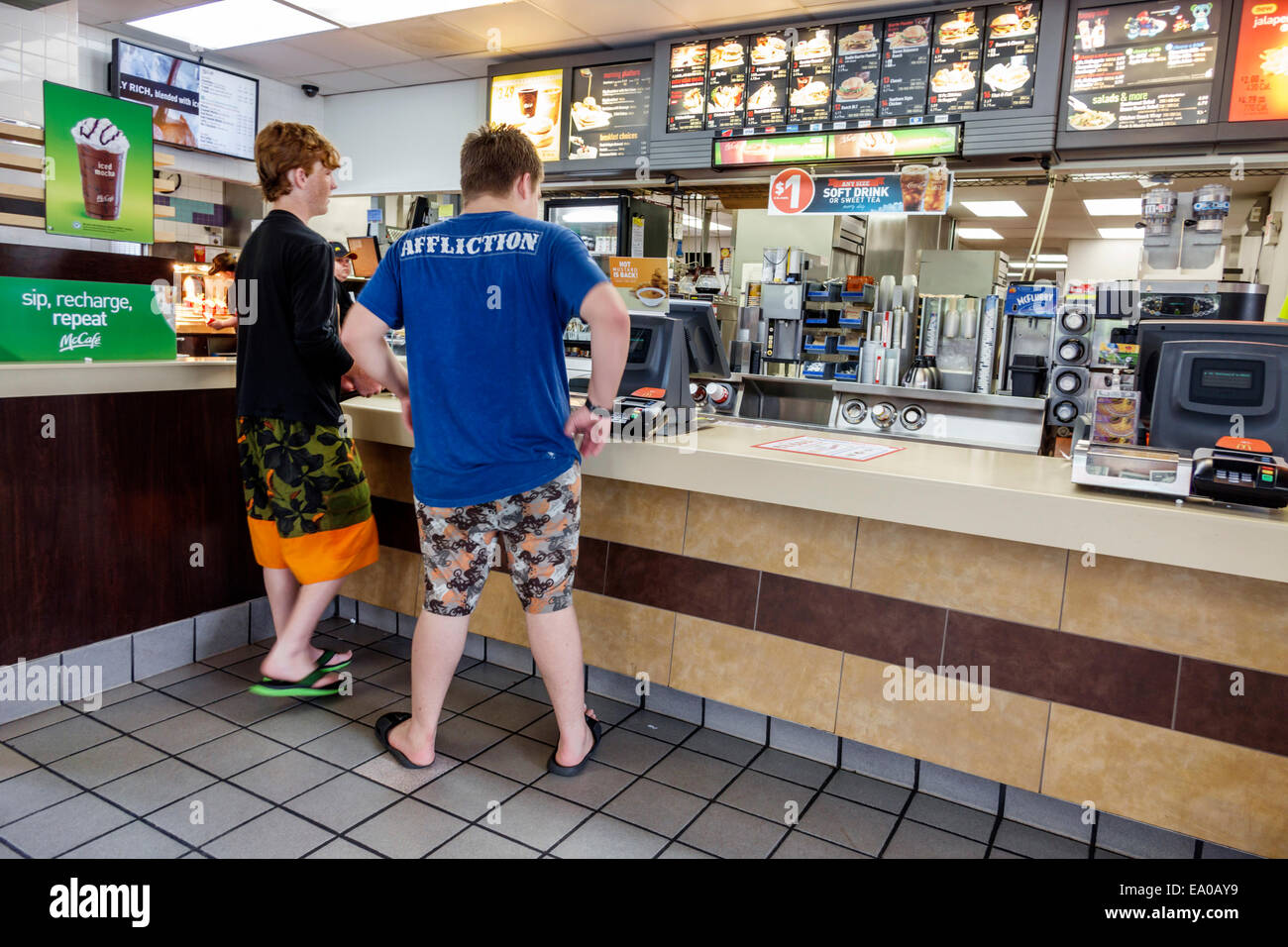 Florida Okeechobee McDonald's restaurant fast food inside counter teen boy friends customers - Stock Image