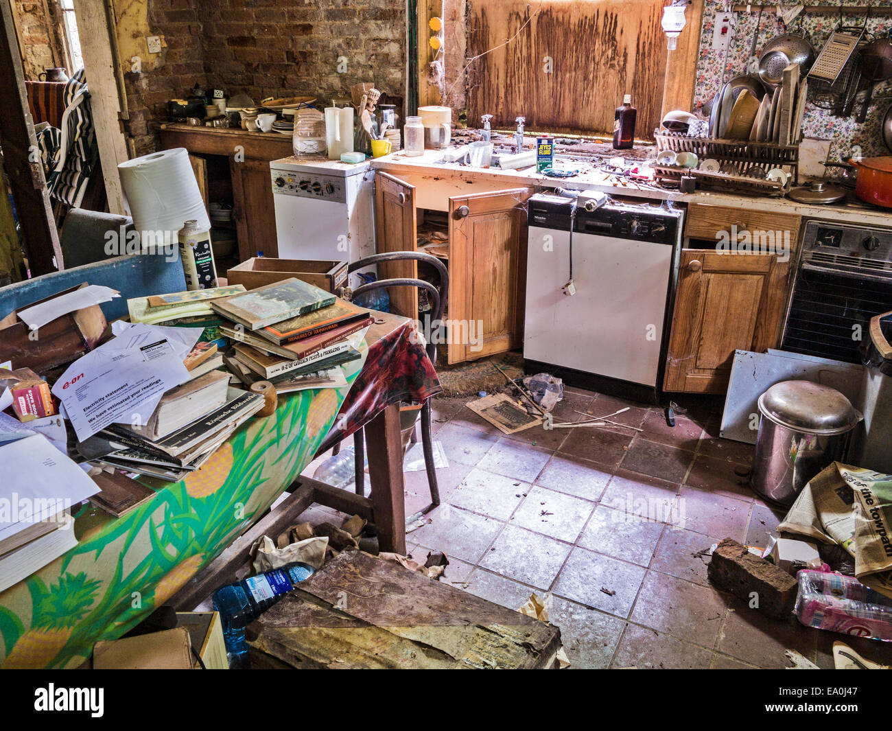 The kitchen of an abandoned and derelict house - Stock Image