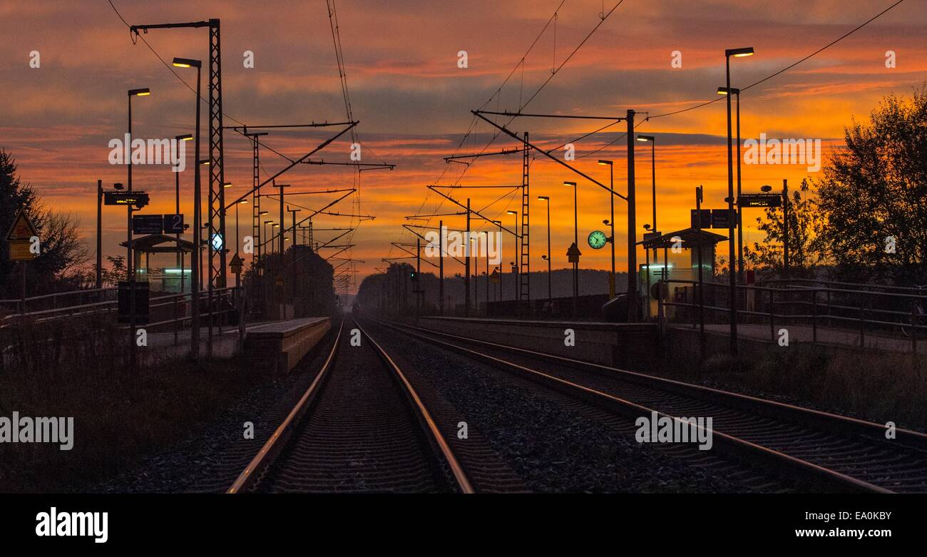 Dawn at the train station in Jacobsdorf, Germany, 05 November 2014. The Deutsche Bahn will begin the longest strike - Stock Image