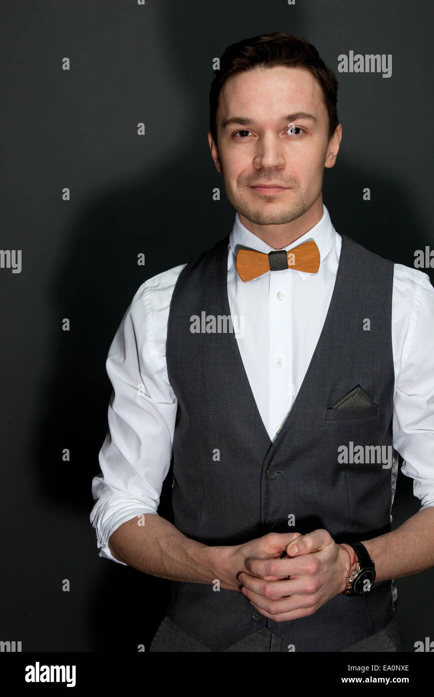 man in suit with bow-tie - Stock Image