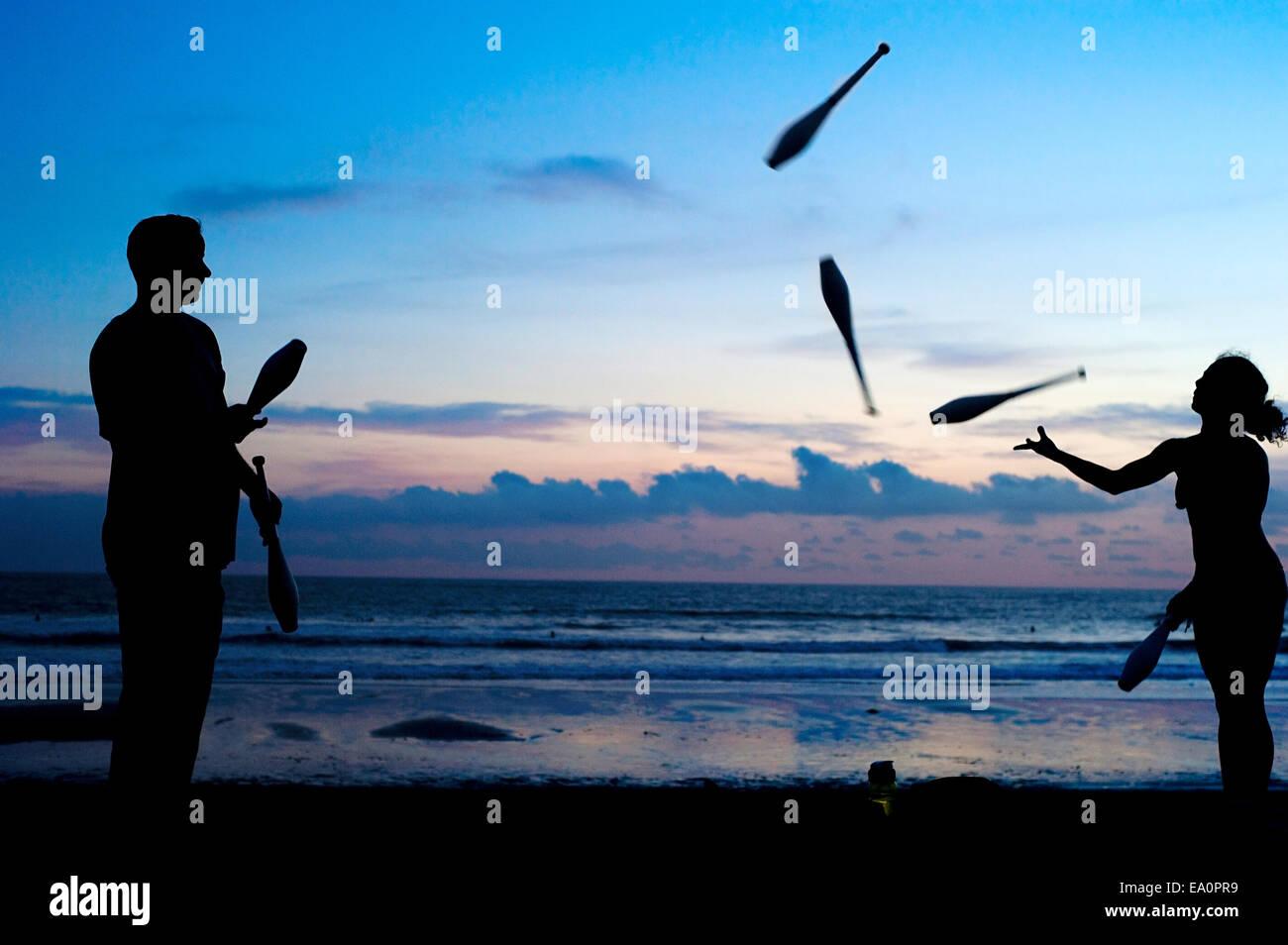 Juggling at sunset - Stock Image