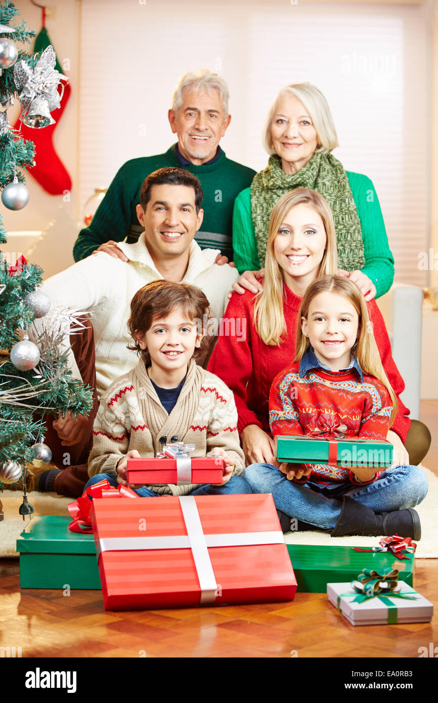 Happy family with seniors and children celebrating christmas - Stock Image