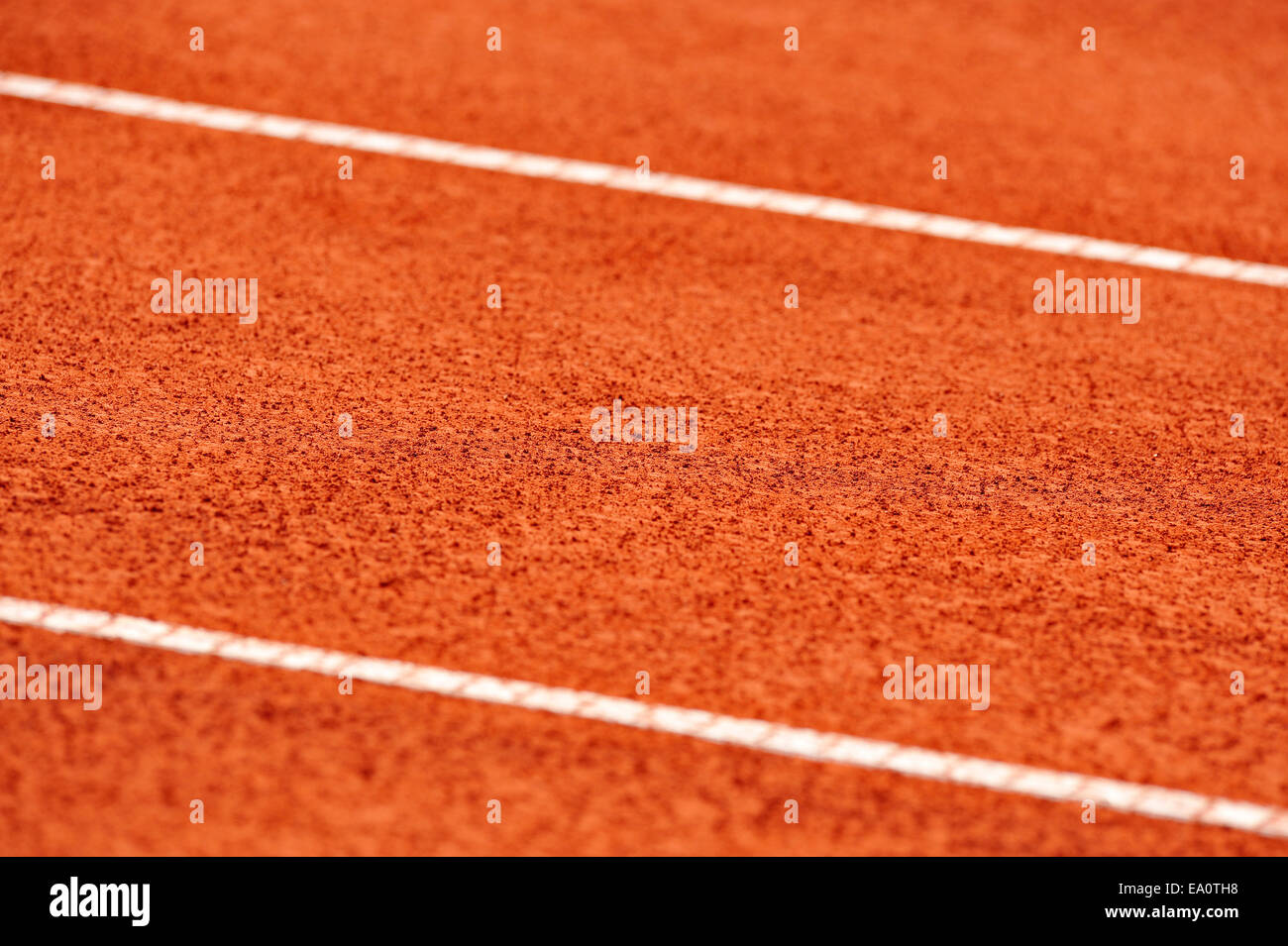 Detail with sidelines on a wet tennis clay court - Stock Image
