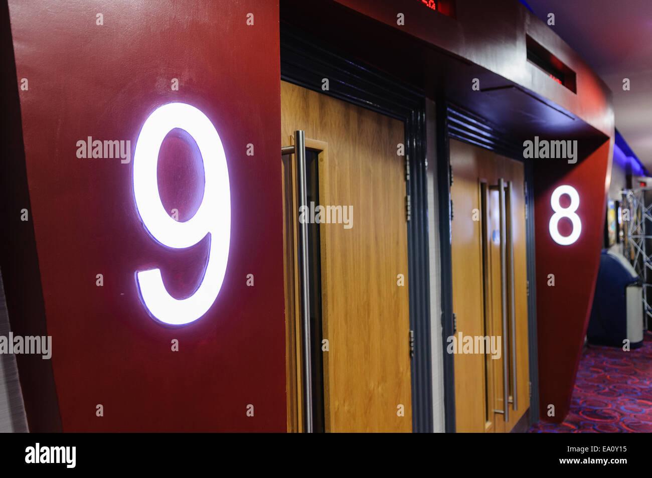 Doors into screens at a multiplex cinema & Doors into screens at a multiplex cinema Stock Photo: 75009233 - Alamy