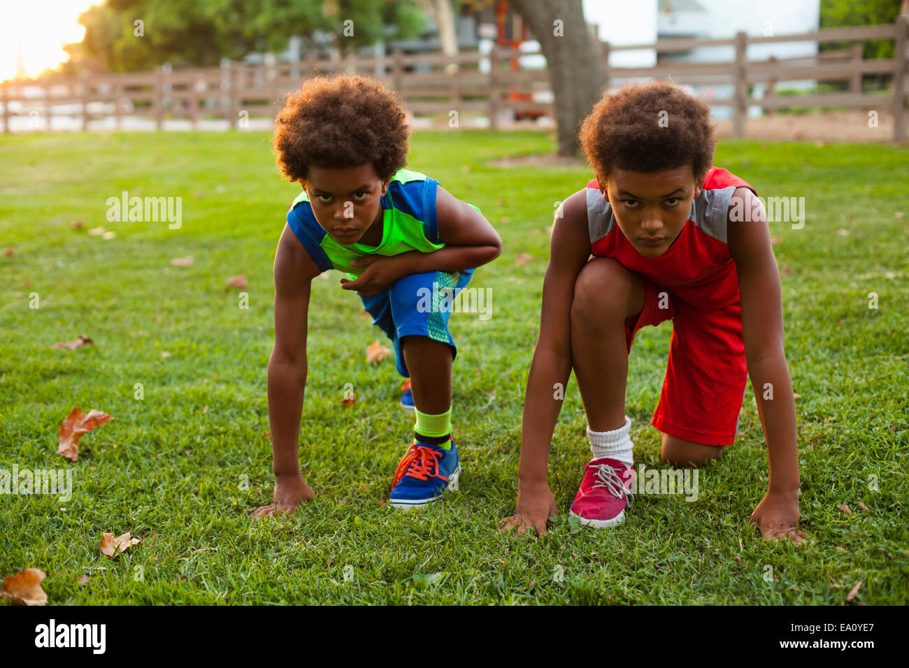 Two brothers preparing to race in park - Stock Image