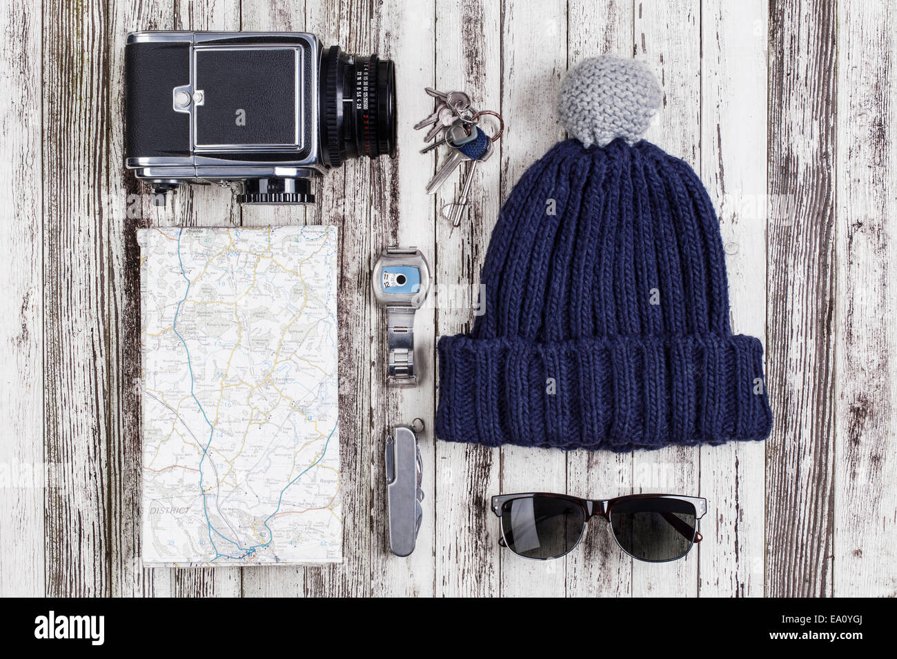 Still life of map with medium format camera and pocket knife - Stock Image