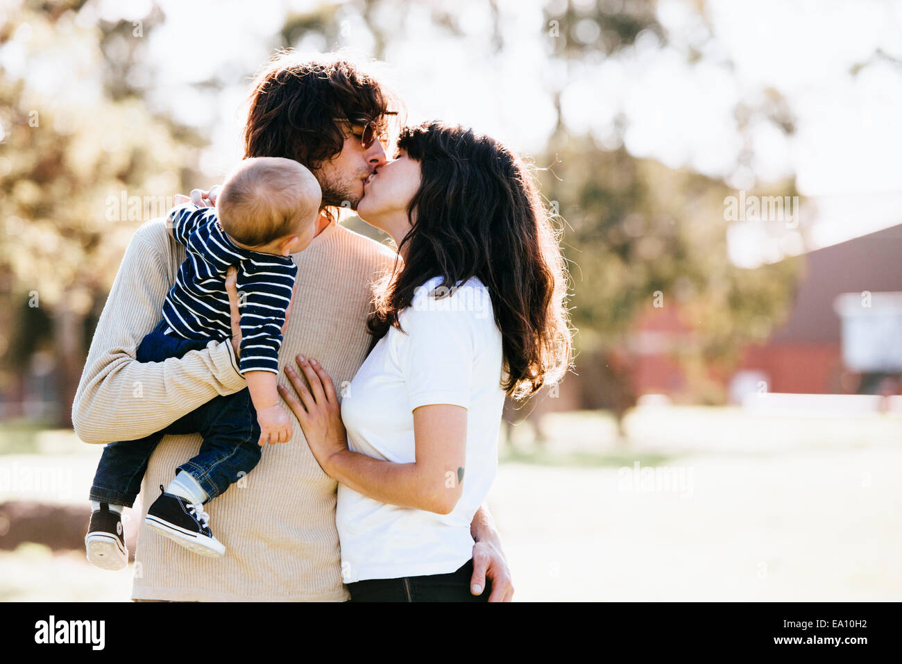 Couple with baby in park - Stock Image