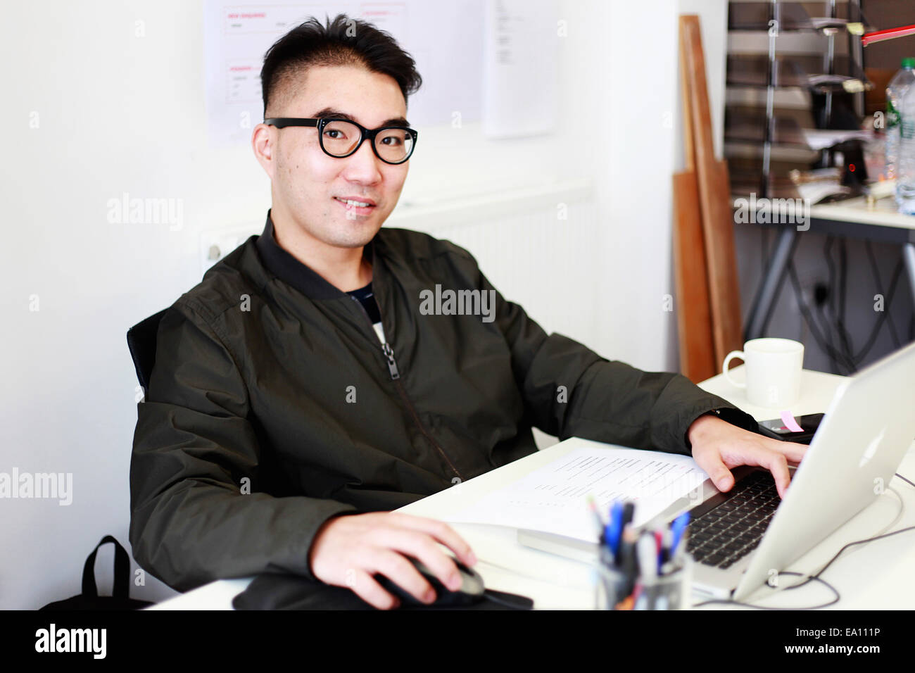 Portrait of male architect at office desk - Stock Image