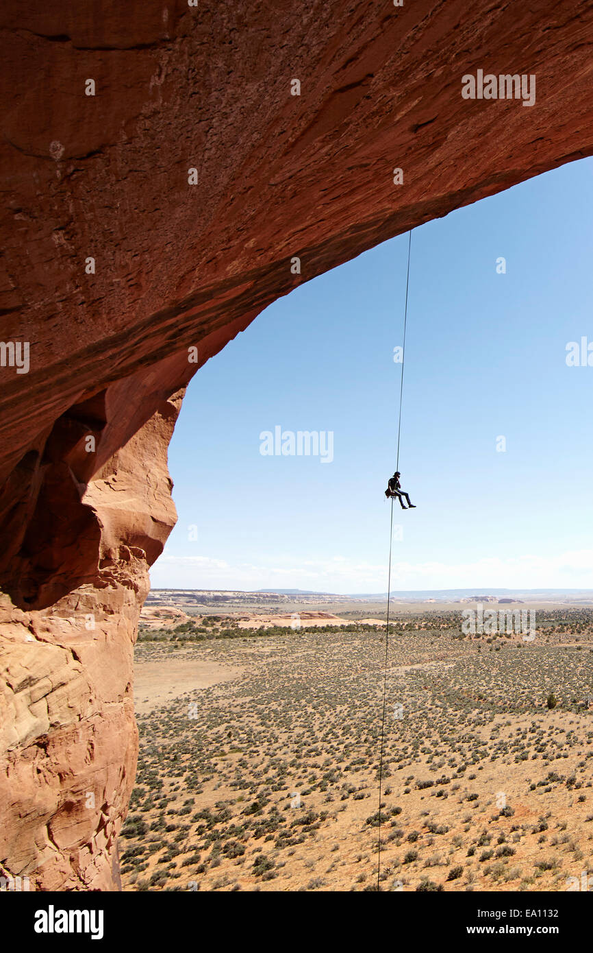 Woman abseiling from arch, Moab, Utah, USA - Stock Image