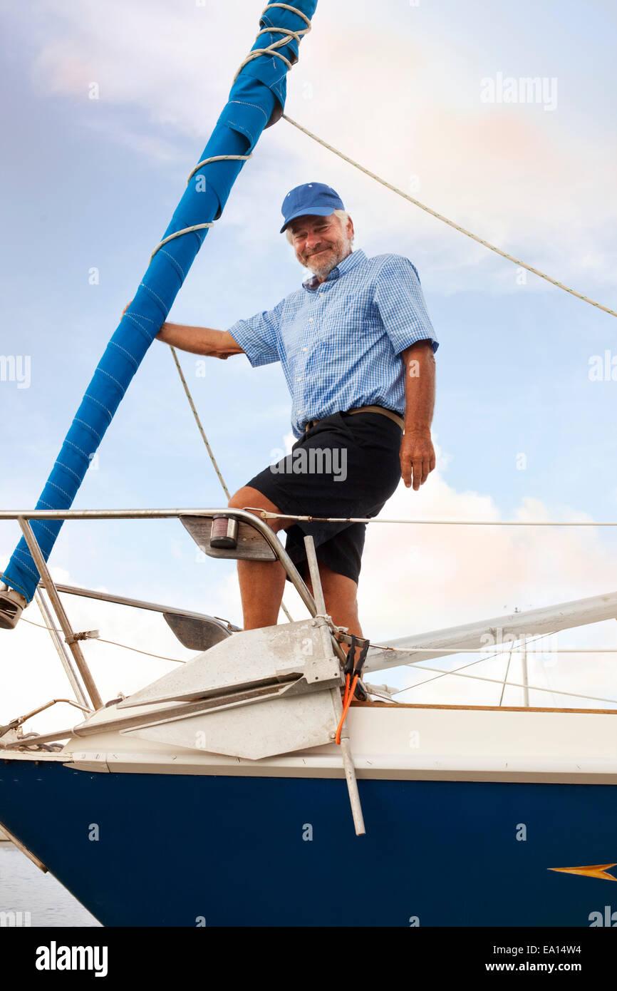 Portrait of senior man on sailboat - Stock Image