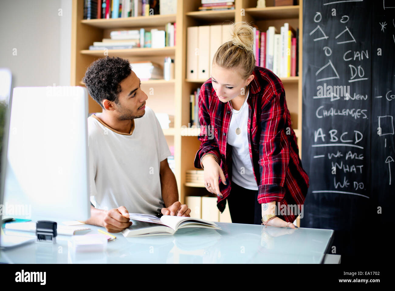 Graphic designers having discussion at work - Stock Image
