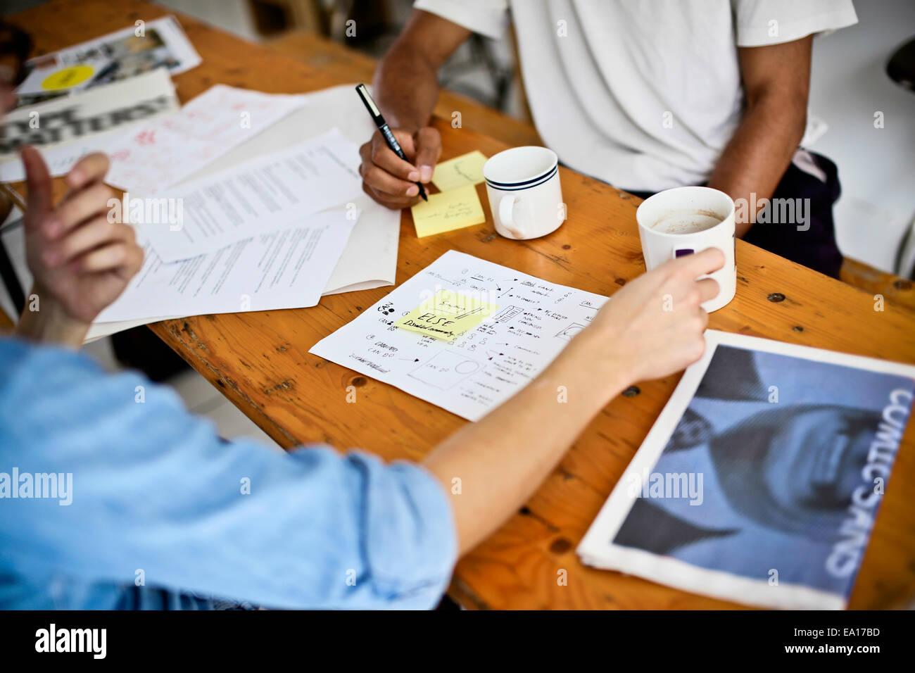 Graphic designers brainstorming - Stock Image