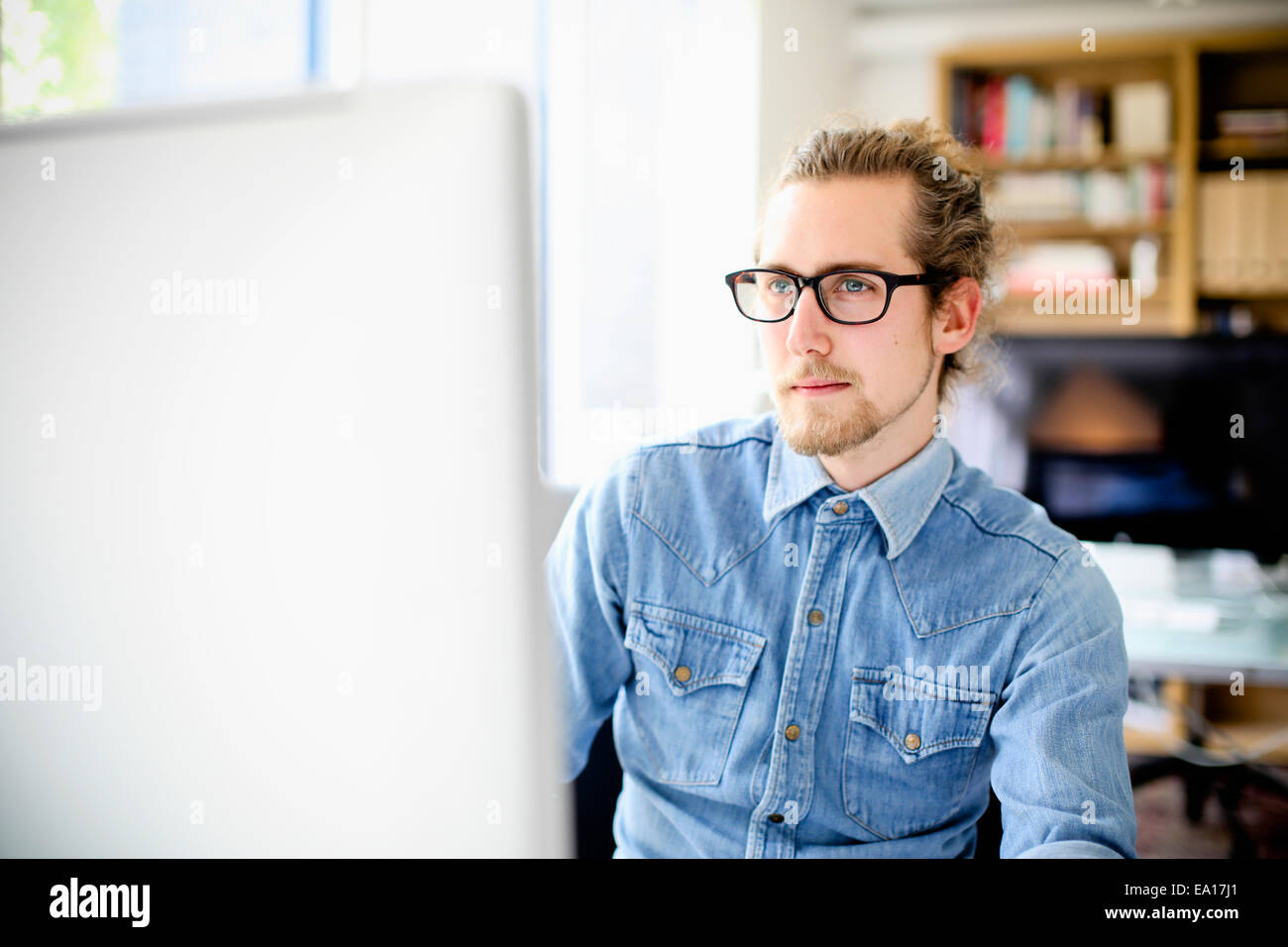 Graphic designer working at computer - Stock Image