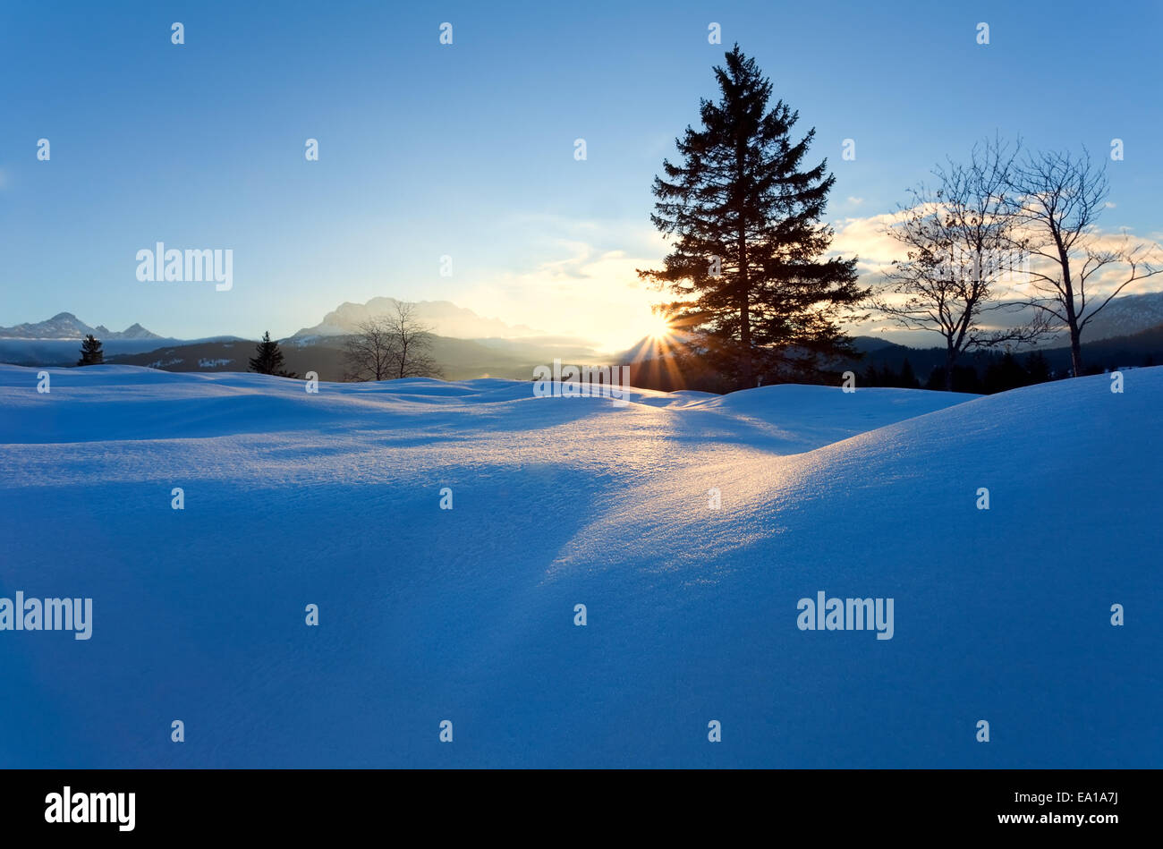 sunset over snow hills in Alps, Bavaria, Germany - Stock Image