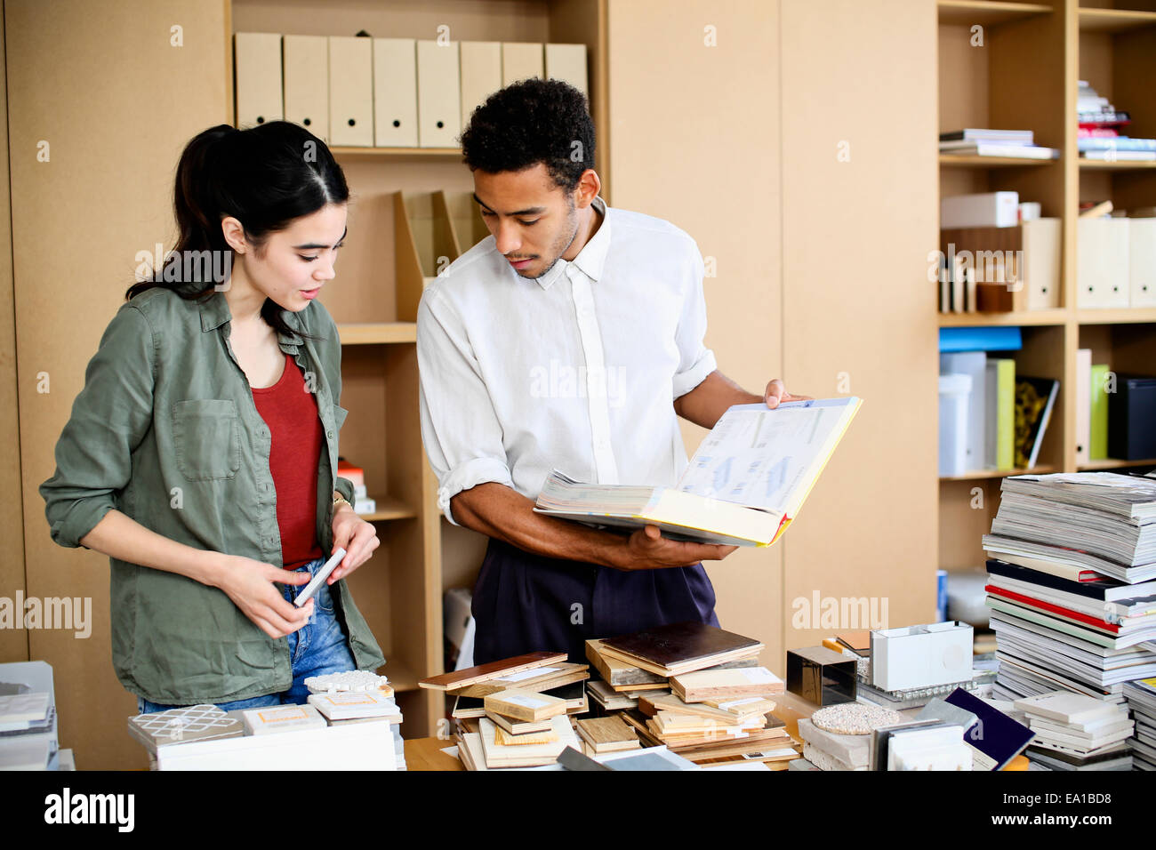 Designers having discussion on samples - Stock Image