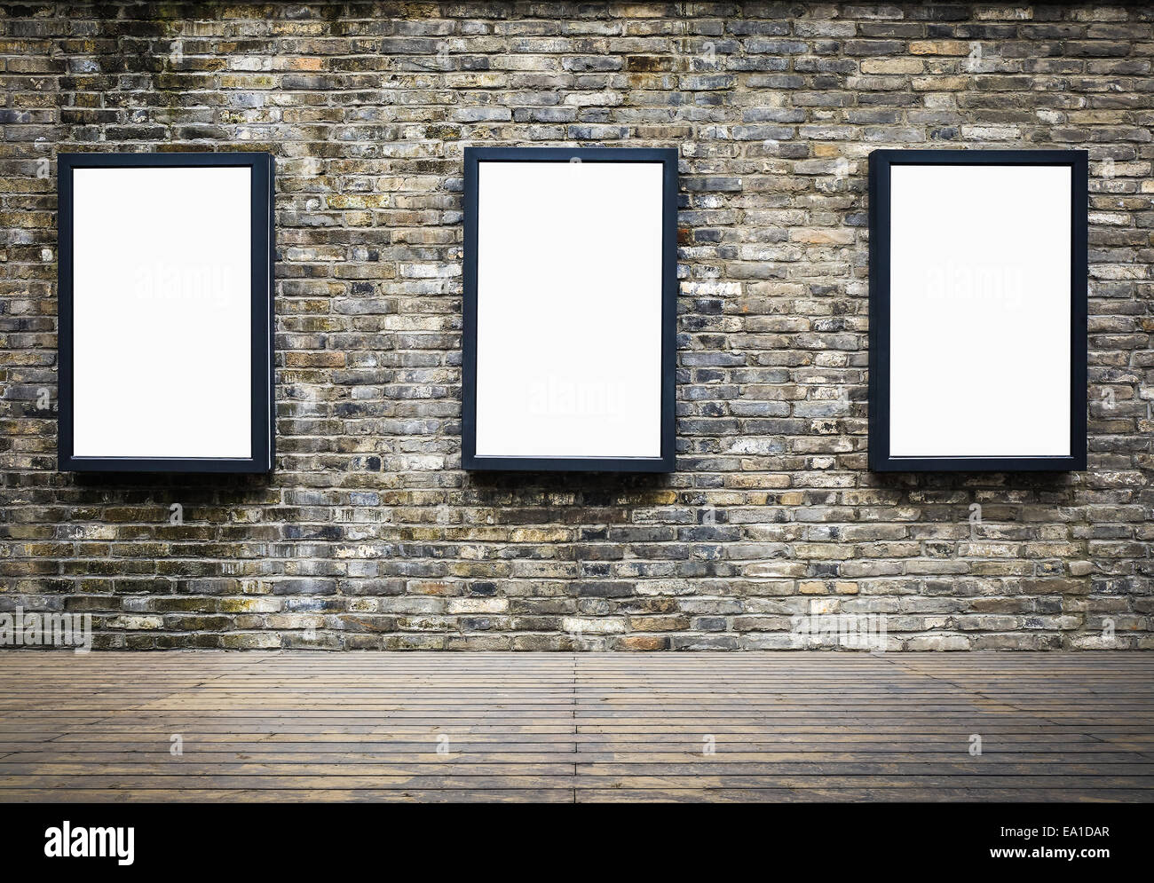 advertising billboard in the old brick wall - Stock Image