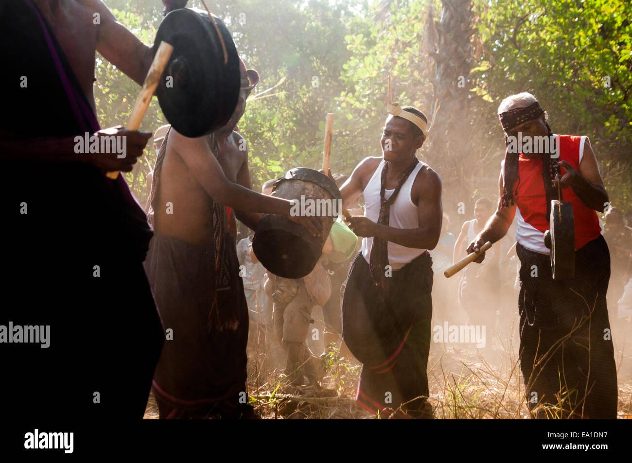 Local people play traditional drums at Lewotolok village, Lembata Island, Indonesia. © Reynold Sumayku - Stock Image