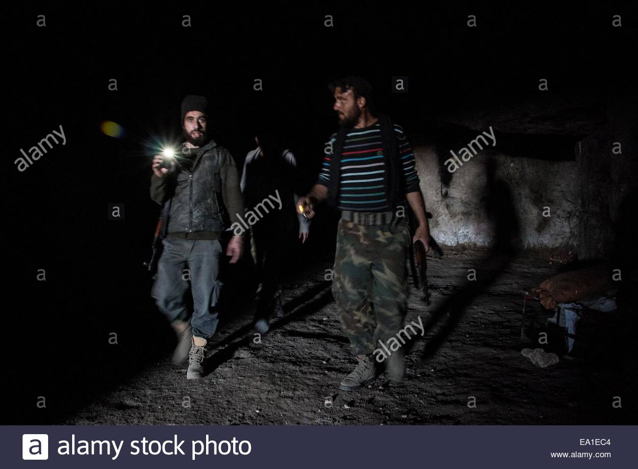 A group of rebels uses mountain caves and tunnels for safe moving in frontlines of Hindarat, on November 4, 2014. - Stock Image