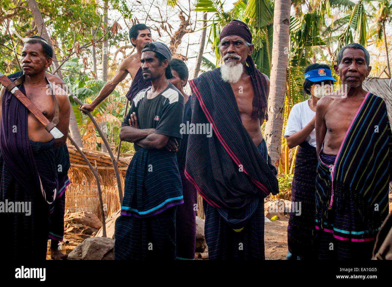 Group portrait of traditional community elders in Lewotolo village, Lembata Island, Indonesia. - Stock Image