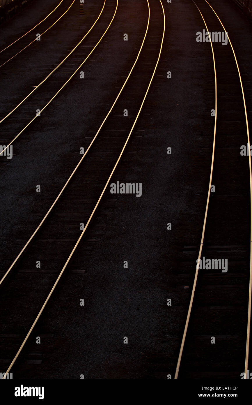 abstract railroad tracks at sunset - Stock Image