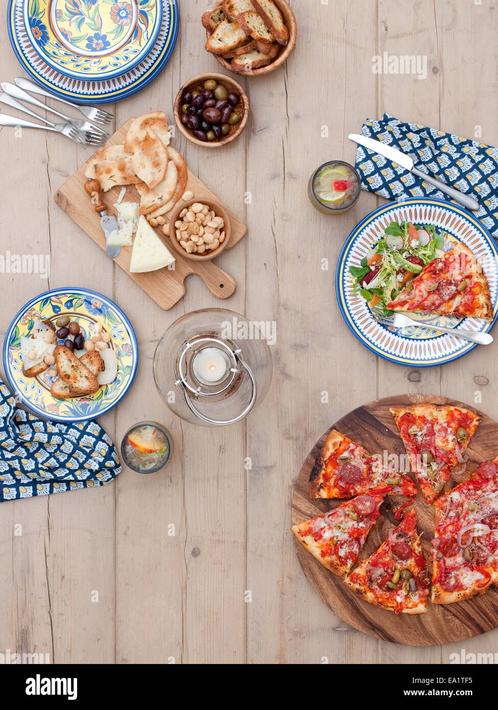 outdoor dining table set with pizza - Stock Image