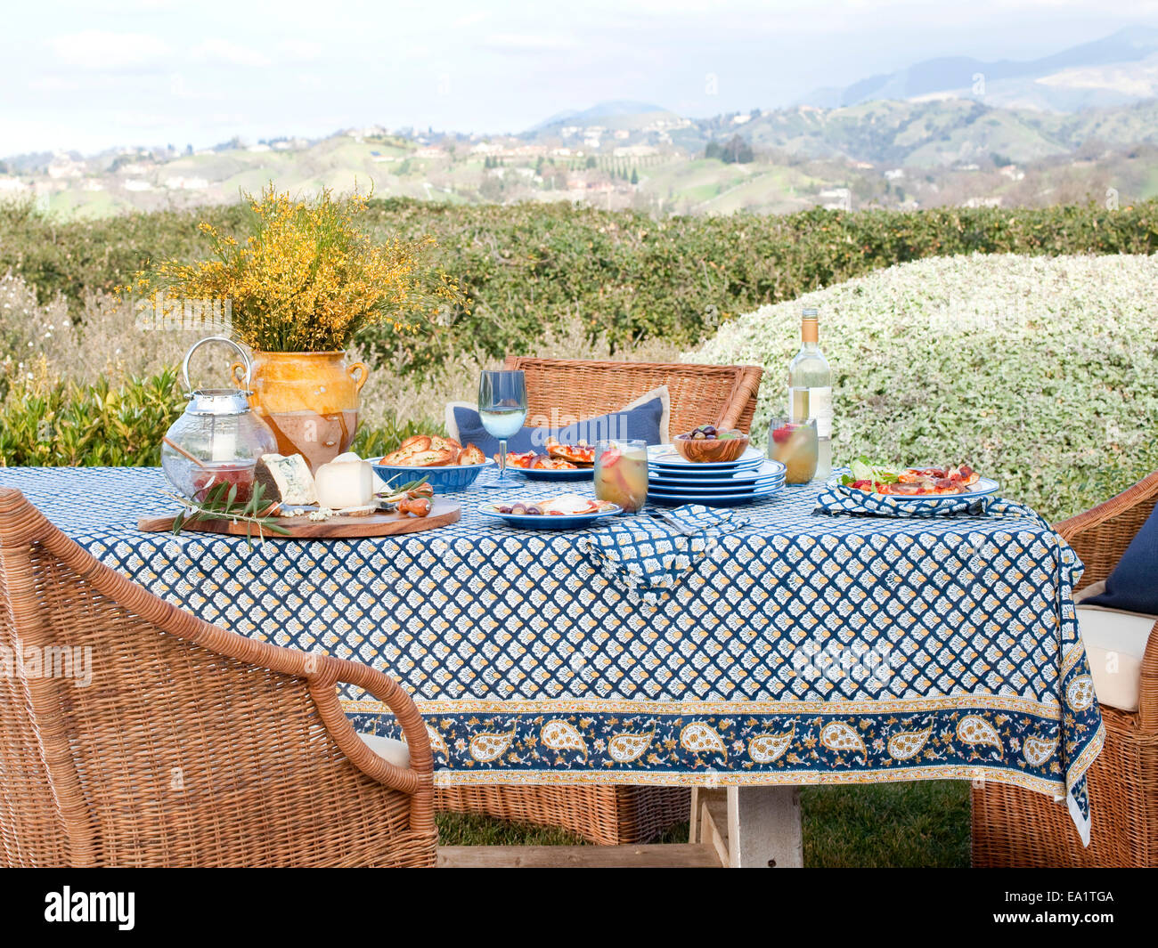 setting the table for a meal outdoors - Stock Image
