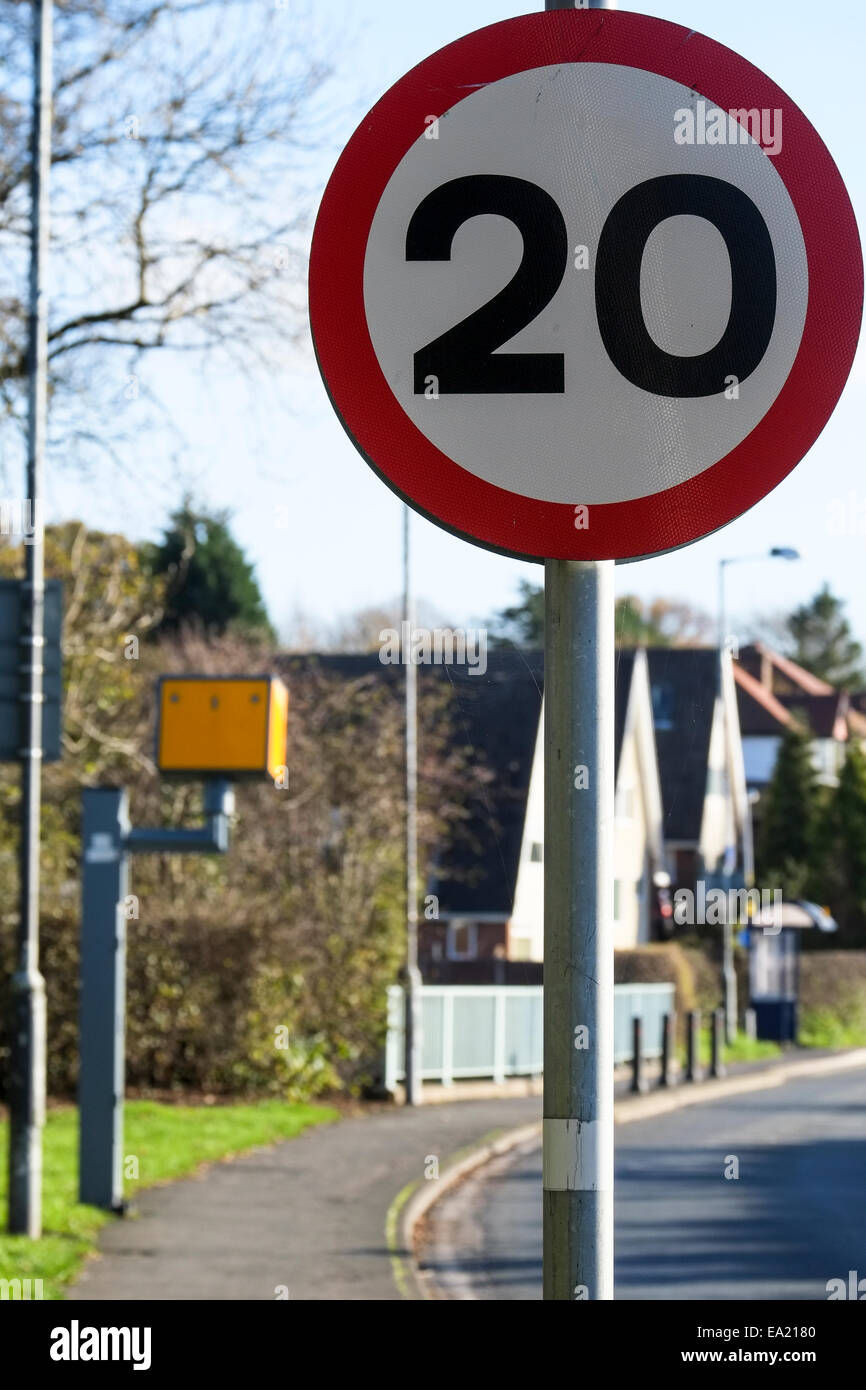 20 miles per hour (MPH) zone sign and speed camera - Stock Image