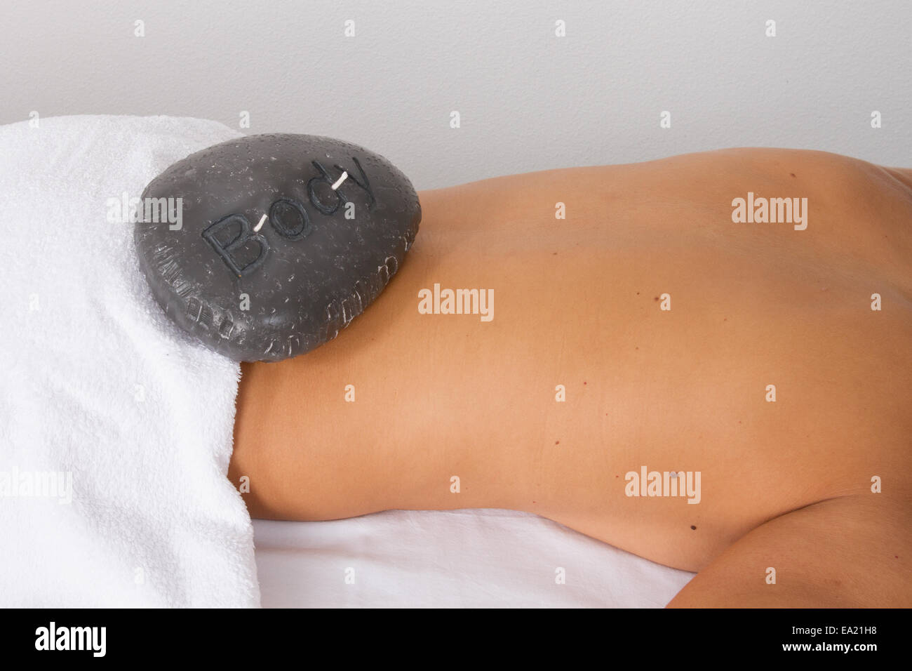 Close up of a beautiful  woman lying on massage table - Stock Image