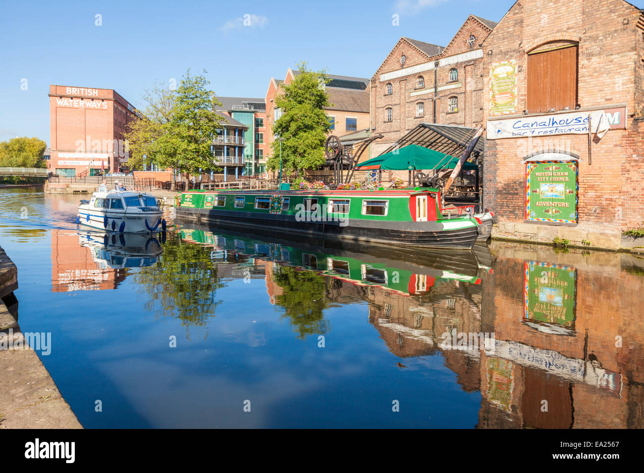Boat, narrowboats and various buildings in Autumn on the Waterfront area of the Nottingham and Beeston Canal, Nottingham, - Stock Image