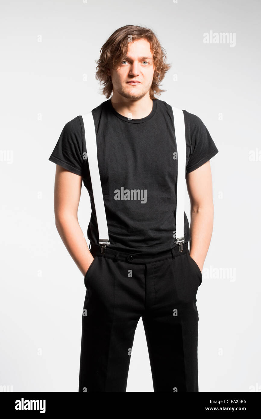 Portrait of a Young Man with Brown Hair and Suspenders - Stock Image