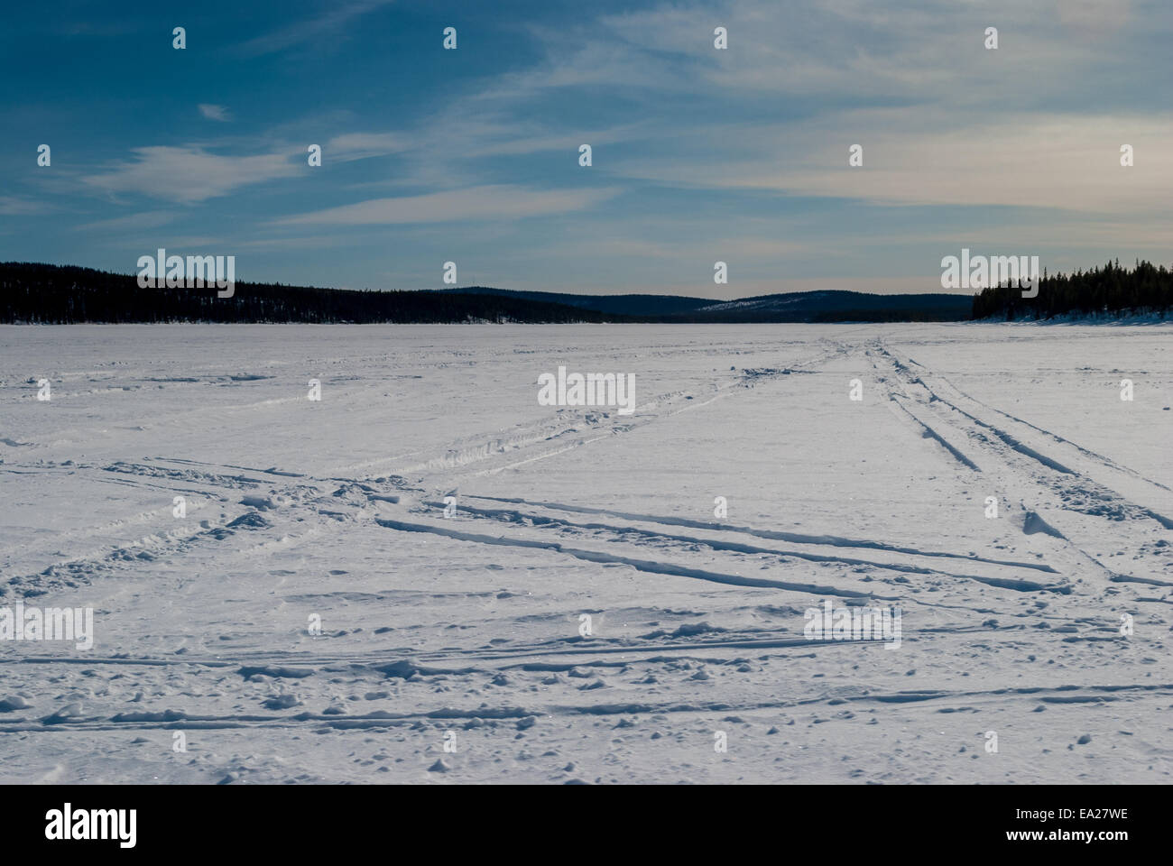 Winter wilderness crossed by snowmobile tracks - Stock Image