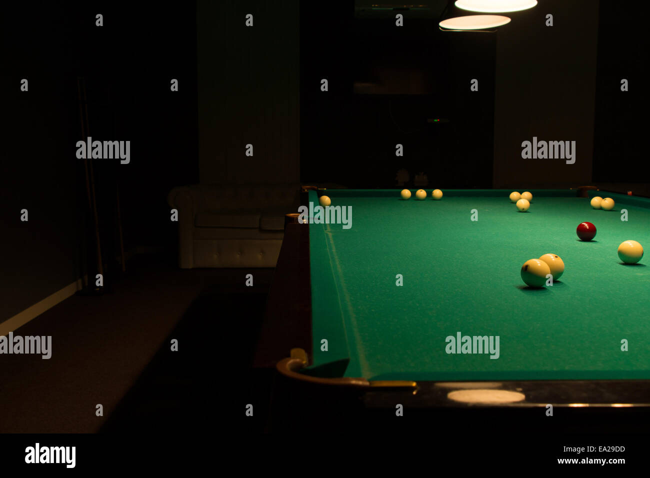Billiard Balls Scattered On Pool Table In Empty Dimly Lit Pool Hall - Pool table hall near me