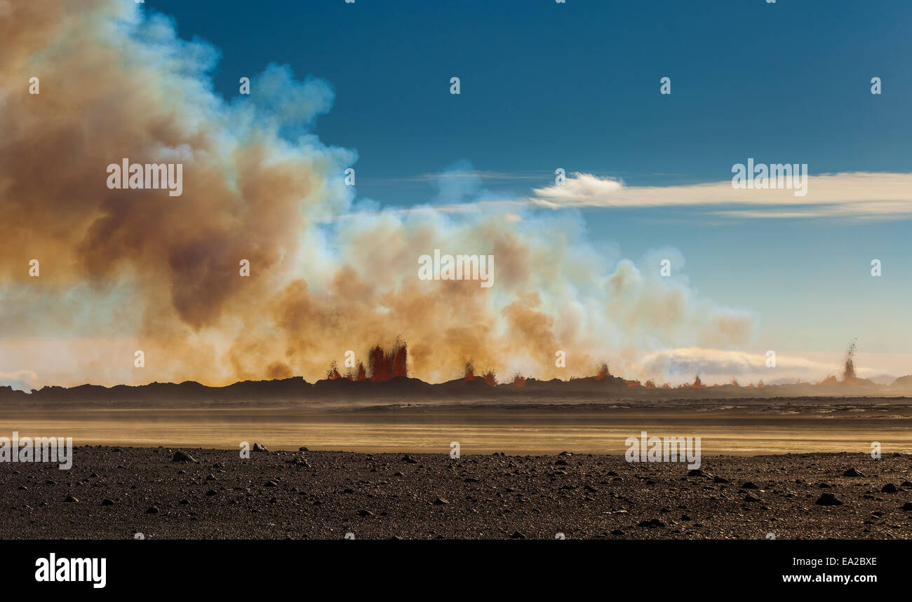 midday view in sun over the iceland volcano eruption - Stock Image