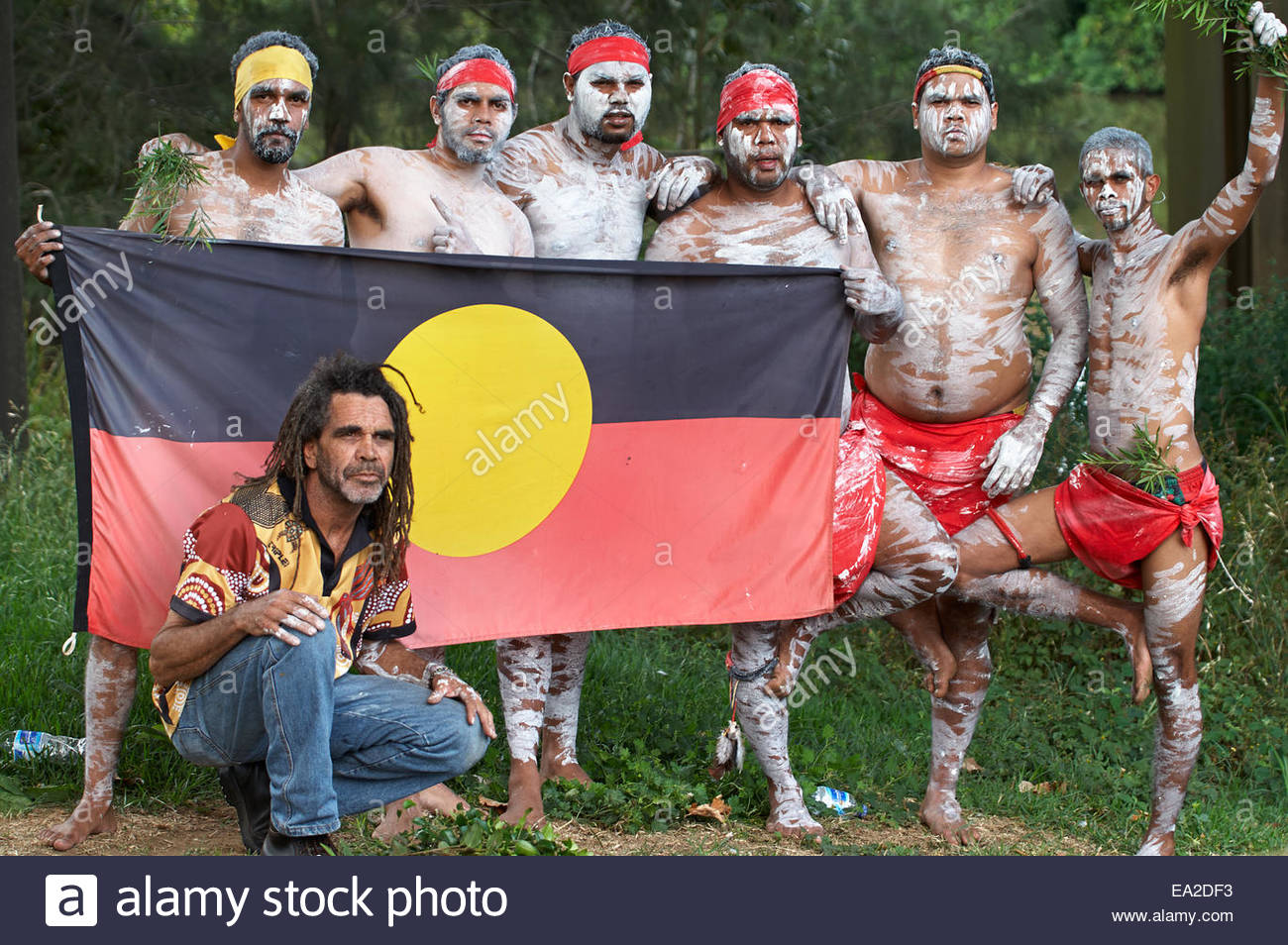 aboriginal uncle and the boys posing with their flag before performing for the gasfield free northern rivers declaration - Stock Image
