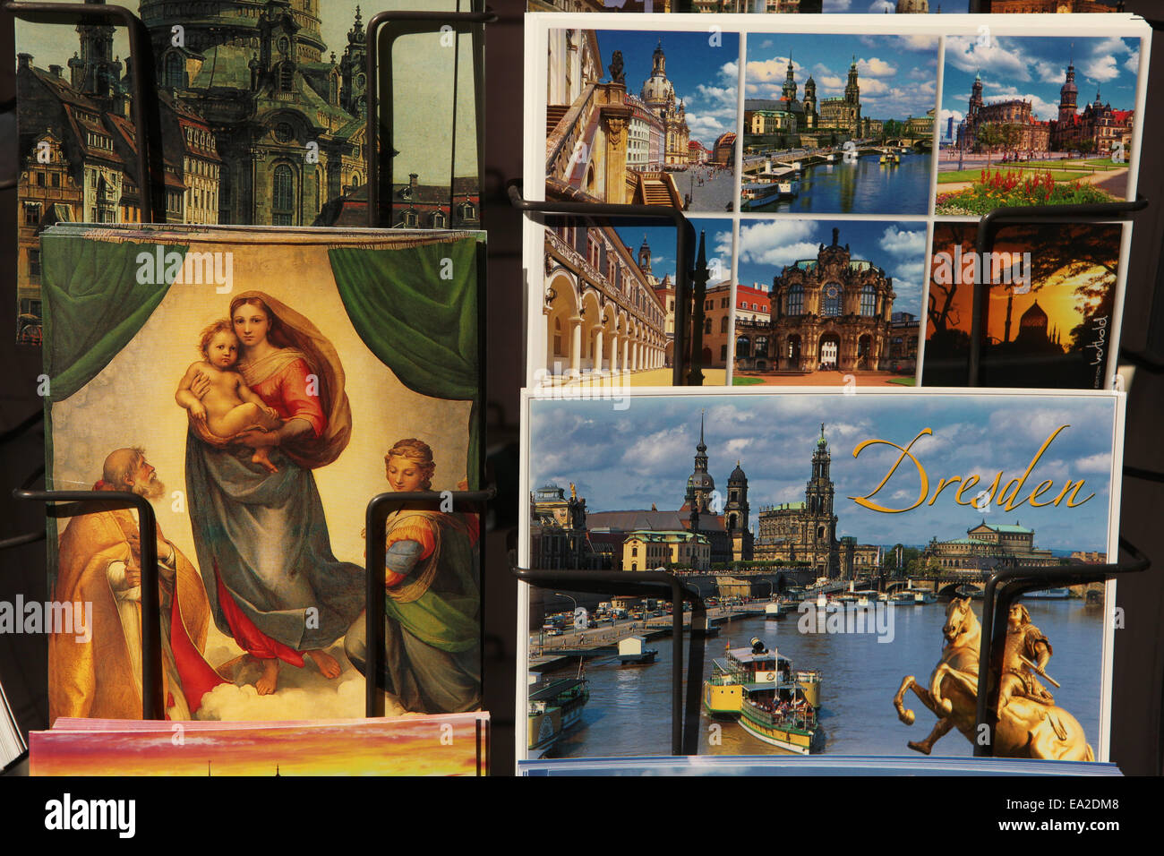 Sistine Madonna by Raphael and postcards with Dresden landmarks in a souvenir shop in Dresden, Saxony, Germany. - Stock Image