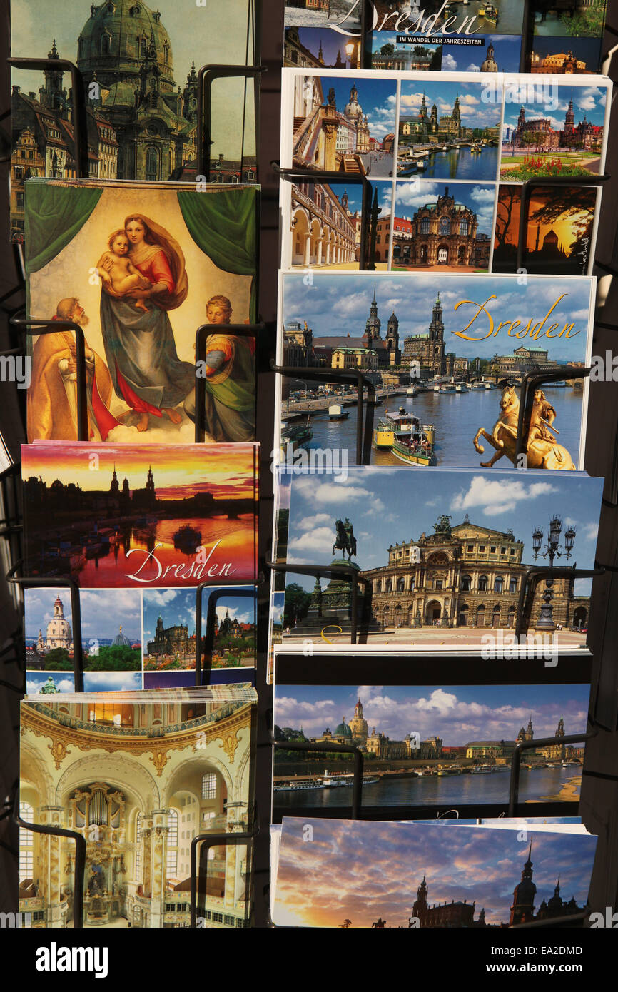 Sistine Madonna by Raphael and postcards with Dresden landmarks in a souvenir shop in Dresden, Saxony, Germany. Stock Photo