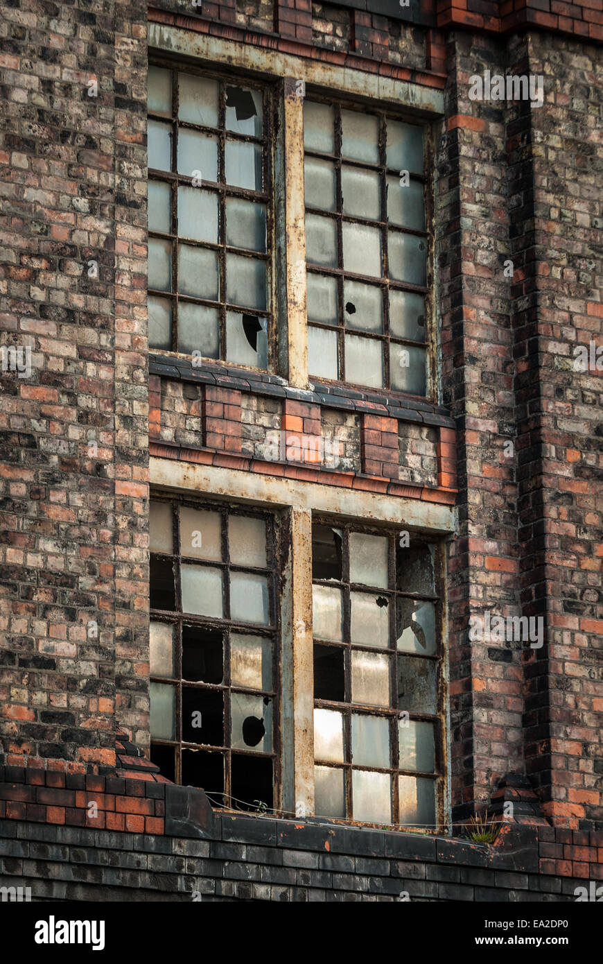 Broken window of a large brick built warehouse at the historic Stanley Dock Tobacco warehouse, Liverpool. Stock Photo